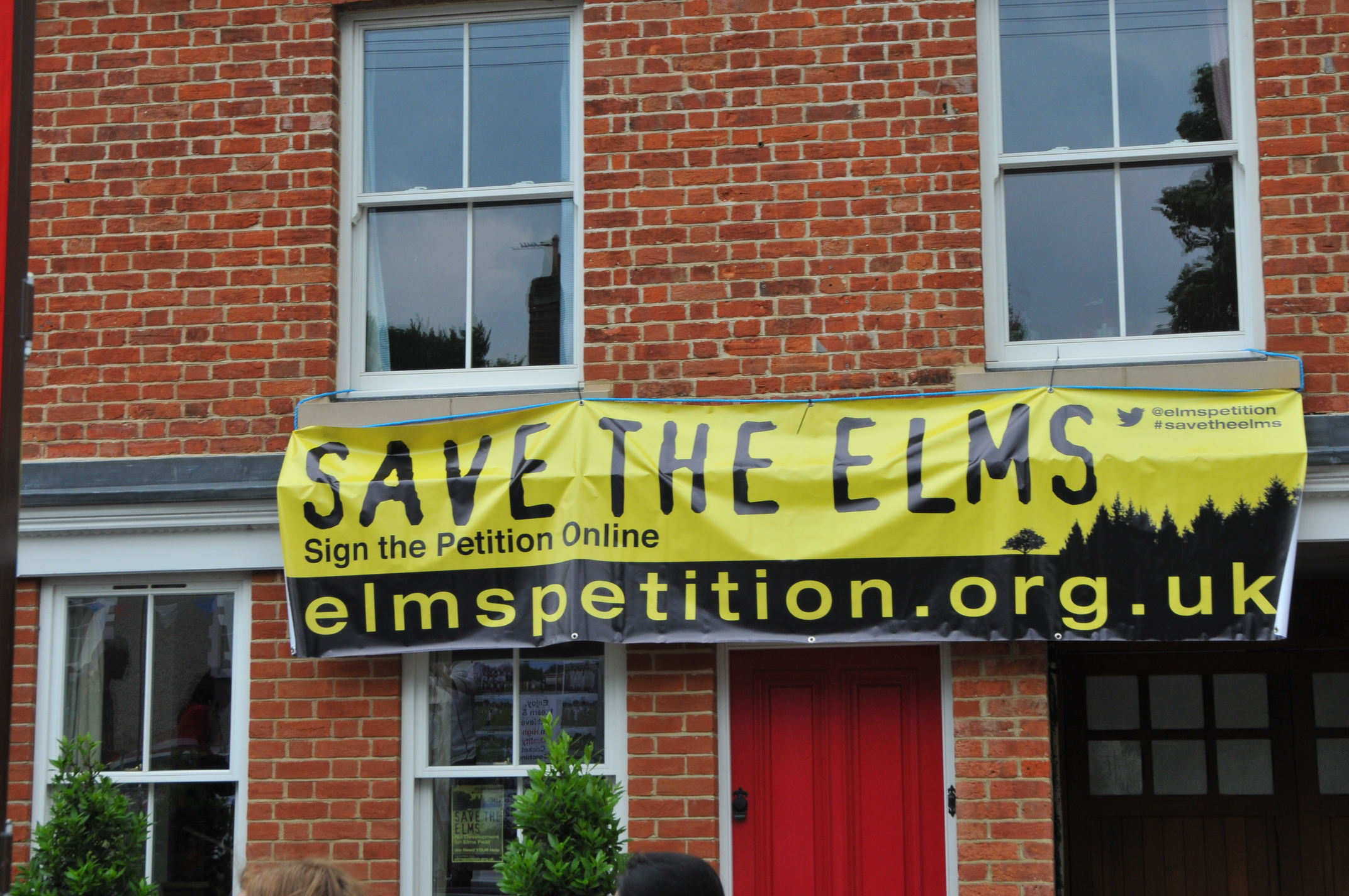 Elms Petition Banner on House